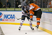Robert Morris defenseman Chase Golightly and RIT forward Erik Brown fight for a puck behind the Robert Morris net during the Atlantic Hockey final at the Blue Cross Arena in Rochester on Saturday, March 19, 2016.