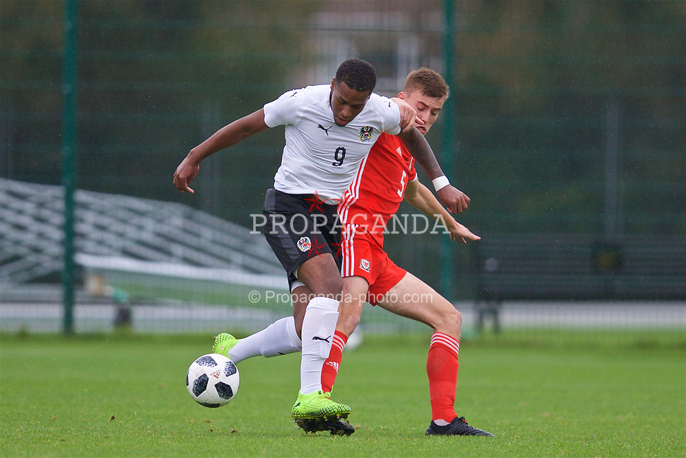 NEWPORT, WALES - Monday, October 14, 2019: Austria's Suliman Mustapha (L) and Wales' Ryan Astley during an Under-19's International Friendly match between Wales and Austria at Dragon Park. (Pic by David Rawcliffe/Propaganda)