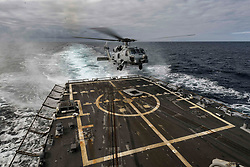 A U.S. Navy MH-60R Sea Hawk helicopter, assigned to Helicopter Maritime Strike Squadron (HSM) 46, Det. 1, lands on the flight deck of the Arleigh Burke-class guided-missile destroyer USS Oscar Austin (DDG 79) in the Atlantic Ocean Aug. 26, 2017. Oscar Austin is on a routine deployment supporting U.S. national security interests in Europe, and increasing theater security cooperation and forward naval presence in the U.S. 6th Fleet area of operations. (U.S. Navy photo by Mass Communication Specialist 2nd Class Ryan U. Kledzik)  Please note: Fees charged by the agency are for the agency's services only, and do not, nor are they intended to, convey to the user any ownership of Copyright or License in the material. The agency does not claim any ownership including but not limited to Copyright or License in the attached material. By publishing this material you expressly agree to indemnify and to hold the agency and its directors, shareholders and employees harmless from any loss, claims, damages, demands, expenses (including legal fees), or any causes of action or allegation against the agency arising out of or connected in any way with publication of the material.