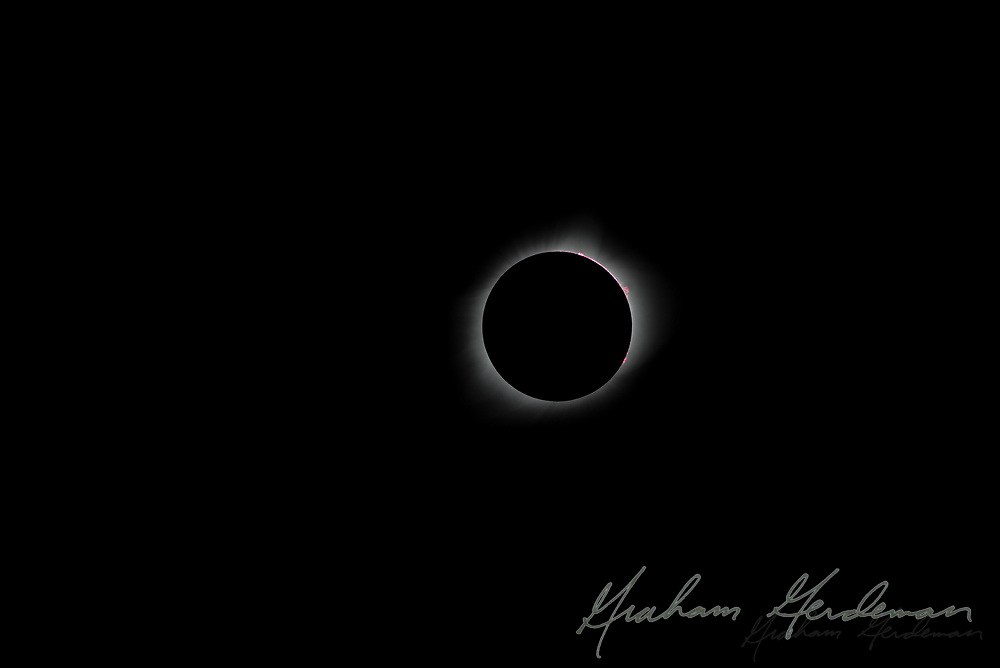 The total solar eclipse of August 21, 2017. Photographed outside Nashville, TN. Red solar flares and slight Bailey's Beads effect.