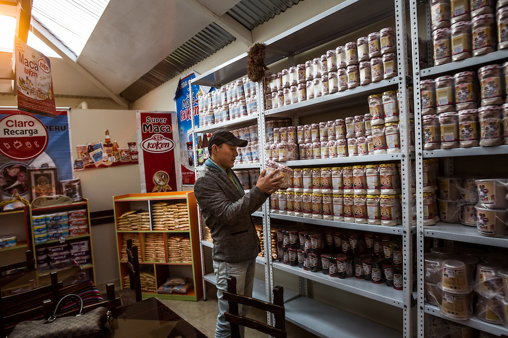 JUN&Iacute;N, PERU - OCTOBER 2, 2014:   Wanque Zhu, a buyer from China, shops for maca products in Jun&igrave;n, Peru. Grown at altitudes approaching 15,000 feet above sea level, maca is one of the latest exotic plants from a remote corner of the world to gain an international following. But nothing prepared farmers for what happened this year, when buyers from China showed up with suitcases full of cash to snap up the harvest, pushing prices into the stratosphere. Within weeks the vegetable, a member of the mustard family with a pungent smell and taste, soared in value, from about $1.80 a pound to over $11 a pound for the most sought after variety of maca.<br /> Fortunes were made overnight. CREDIT: Meridith Kohut for The New York Times