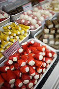 The Naschmarkt, Vienna's biggest market. Piccola Italia delicatessen. Chili peppers filled with feta cheese and other delicacies.