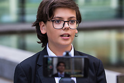 London, UK. 30th April 2019. Climate change activist from Extinction Rebellion Felix Ottaway O'Mahony, a 14-year-old secondary school student, is interviewed outside the Home Office after attending a meeting hosted by the Secretary of State for the Environment Michael Gove.