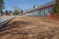 Hanover Elementary School - Kindergarten Addition.James R Anderson Photographer | photog.com 203-281-0717.Andrade Architects, LLC. Enfield Builders, Inc..Photography Date: 7 March 2012.Camera View: North. Existing School West Elevation, New Addition East Elevation and backfill..Image Number 03