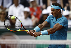 June 10, 2018 - Paris, Ile-de-France, France - Rafael Nadal of Spain hits a forehand to Dominic Thiem of Austria in the final of the men's singles at Roland Garros during the French Open on June 10, 2018 in Paris, France. (Credit Image: © Mehdi Taamallah/NurPhoto via ZUMA Press)