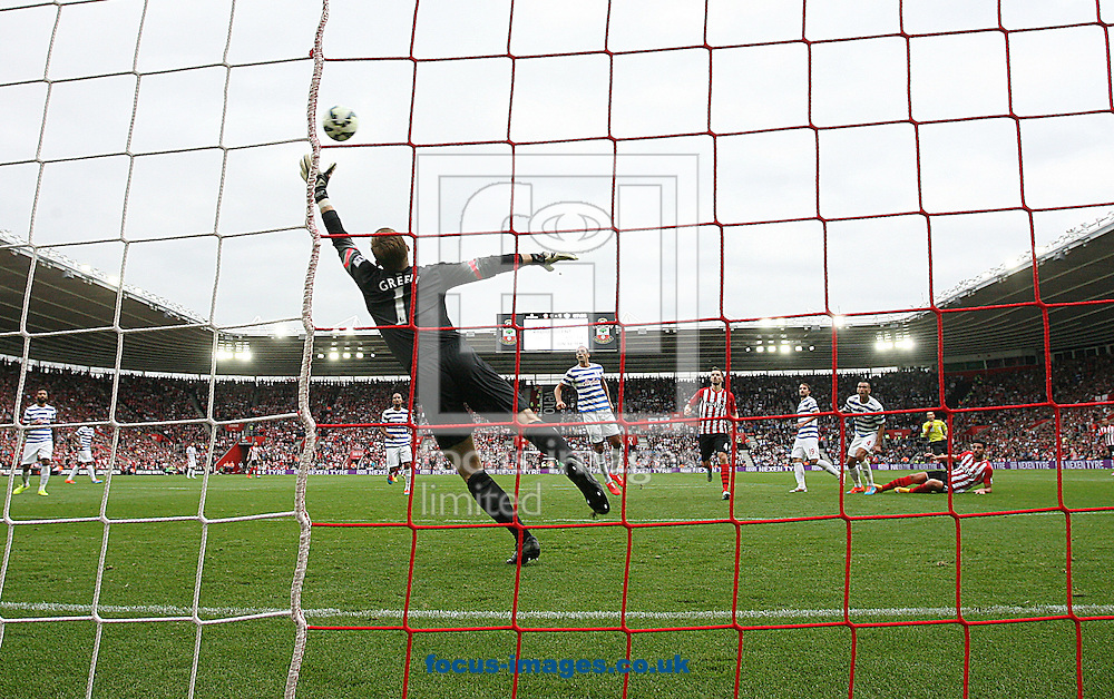 Graziano Pelle ( R ) of Southampton scores to make it 2-1 as Robert Green (C )  of Queens Park Rangers fails to save the shot during the Barclays Premier League match at the St Mary's Stadium, Southampton<br /> Picture by Paul Terry/Focus Images Ltd +44 7545 642257<br /> 27/09/2014
