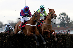 La Bague Au Roi and Richard Johnson (L) clear the last fence with Topofthegame and Harry Cobden before going on to win The 32Red Kauto Star NovicesÕ Steeple Chase Race run during day one of 32Red Winter Festival at Kempton Park Racecourse.