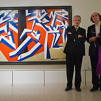 "VENICE, ITALY - JANUARY 28:  The Director of the Guggenheim Museum Philip Rylands (L) and the nephew of Futurist poet Marinetti, Leonardo Clerici (R) pose in front of the painting by David Bomberg ""The Mud Bath "" at the press launch of the Vorticist exhibition on January 28, 2011 in Venice, Italy. The Vorticists: Rebel Artists in London and New York, 1914-1918, is the first exhibition devoted to Vorticism to be presented in Italy will be open at the Peggy Guggenheim Collection from  January 29 through May 15, 2011."