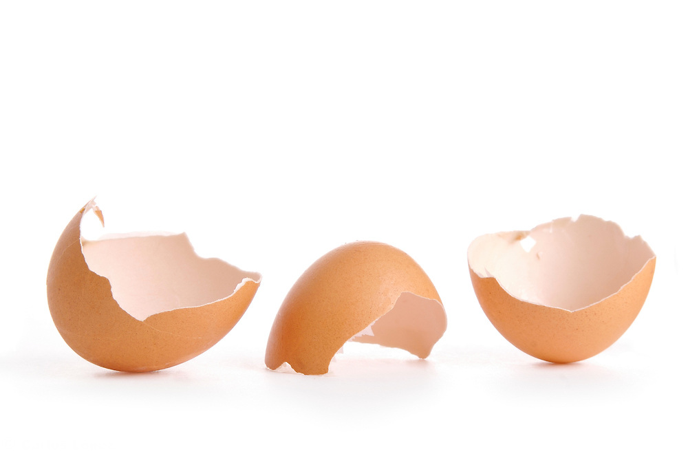Still life of three  eggs on a plate.