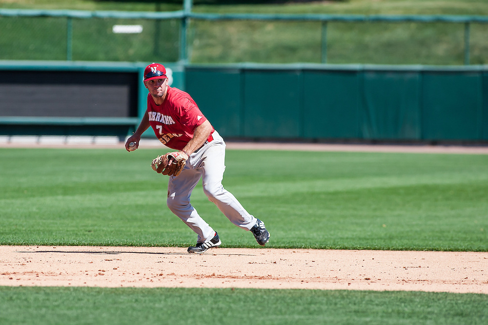September 04, 2012: Bryan Peters scoops up a grounder during fall baseball practice. Photo by John S. Peterson.