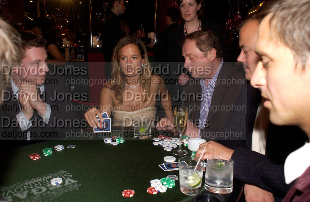 Anthony Holden and Jade Jagger. . PARTYPOKER.COM masterclass hosted by poker author Tony Holden. Ultra Lounge, Selfridges. 11 May 2005. ONE TIME USE ONLY - DO NOT ARCHIVE  © Copyright Photograph by Dafydd Jones 66 Stockwell Park Rd. London SW9 0DA Tel 020 7733 0108 www.dafjones.com