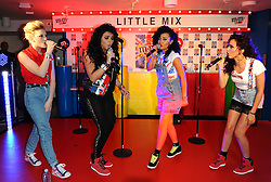 Jade Thirlwall, Leigh-Ann Pinnock, Perrie Edwards and Jesy Nelson of Little Mix Perform at the M&M Store, Leicester square, London. Thursday May 24, 2012. Photo By Chris Josepth/i-Images