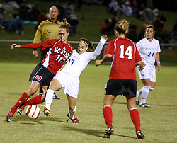 VIrginia's Kara Fredrick (#17) fights off NC State's Megan Sadler (#12) in the second half.  The Wahoos beat NC State 2-0.