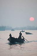 A ferry moves its way along the Karnaphuli river at sunset in Chittagong, Bangladesh.