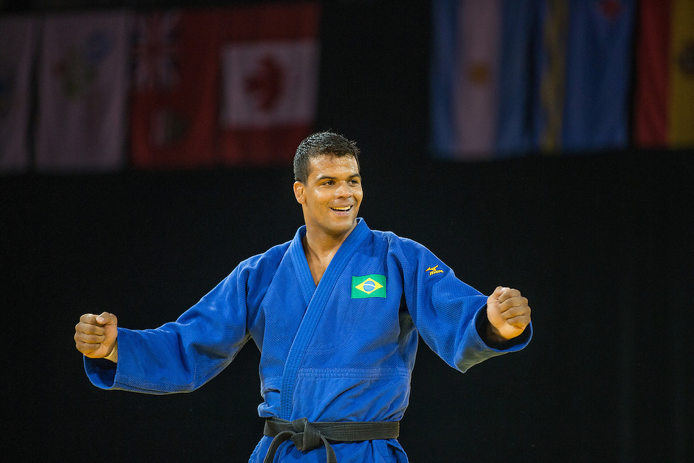 Luciano Correa of Brazil celebrates after defeating  Marc Deschenes of Canada to win the gold medal in the mens judo -100kg class at the 2015 Pan American Games in Toronto, Canada, July 14,  2015.  AFP PHOTO/GEOFF ROBINS