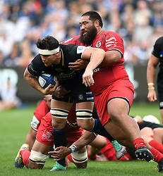 Francois Louw of Bath Rugby is tackled by Charlie Faumuina of Toulouse - Mandatory byline: Patrick Khachfe/JMP - 07966 386802 - 13/10/2018 - RUGBY UNION - The Recreation Ground - Bath, England - Bath Rugby v Toulouse - Heineken Champions Cup
