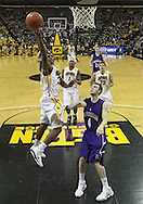 January 12 2010: Iowa Hawkeyes guard Bryce Cartwright (24) puts up a shot over Northwestern Wildcats guard Alex Marcotullio (4) during the second half of an NCAA college basketball game at Carver-Hawkeye Arena in Iowa City, Iowa on January 12, 2010. Northwestern defeated Iowa 90-71.