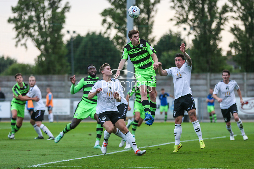 Forest Green Rovers Luke James(33) jumps up to head a corner during the Pre-Season Friendly match between Weston Super Mare and Forest Green Rovers at the Woodspring Stadium, Weston Super Mare, United Kingdom on 18 July 2017. Photo by Shane Healey.