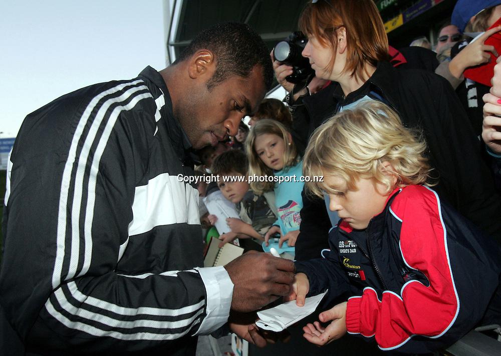 Sitiveni Sivivatu signs autographs after the All Blacks open training session at North Harbour Stadium, Auckland, New Zealand on Sunday 5 June, 2005. Photo: Hannah Johnston/PHOTOSPORT