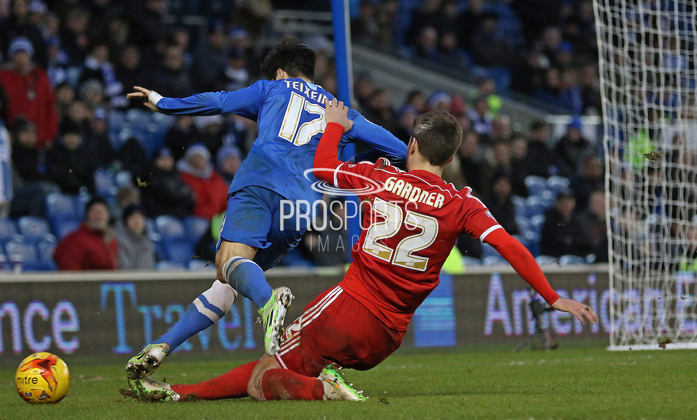 Brighton's Joao Teixeira is tackled by Nottingham Forest's Gary Gardner during the Sky Bet Championship match between Brighton and Hove Albion and Nottingham Forest at the American Express Community Stadium, Brighton and Hove, England on 7 February 2015. Photo by Phil Duncan.
