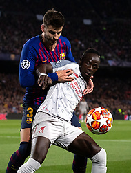 BARCELONA, May 2, 2019  FC Barcelona's Gerard Pique (L) vies with Liverpool's Sadio Mane during the UEFA Champions League semifinal first leg soccer match between FC Barcelona and Liverpool in Barcelona, Spain, on May 1, 2019. Barcelona won 3-0. (Credit Image: © Joan Gosa/Xinhua via ZUMA Wire)