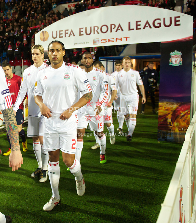 LILLE, FRANCE - Thursday, March 11, 2010: Liverpool's captain Glen Johnson walks out to face LOSC Lille Metropole during the UEFA Europa League Round of 16 1st Leg match at the Stadium Lille-Metropole. (Photo by David Rawcliffe/Propaganda)