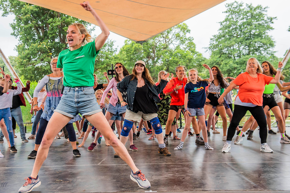 Henham Park, Suffolk, 19 July 2019. Matthew Bourne's New Adventures workshop includes entusiastic crowd participation (of all ages) to recreate parts of Swan Lake - The 2019 Latitude Festival.