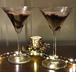"""Courteney Cox releases a photo on Twitter with the following caption: """"""""Wanna a fun drink recipe for New Year's Eve? Check out this divine (4 ingredient) CHOCOLATE MARTINI! https://t.co/XPPnjOFkPK"""""""". Photo Credit: Twitter *** No USA Distribution *** For Editorial Use Only *** Not to be Published in Books or Photo Books ***  Please note: Fees charged by the agency are for the agency's services only, and do not, nor are they intended to, convey to the user any ownership of Copyright or License in the material. The agency does not claim any ownership including but not limited to Copyright or License in the attached material. By publishing this material you expressly agree to indemnify and to hold the agency and its directors, shareholders and employees harmless from any loss, claims, damages, demands, expenses (including legal fees), or any causes of action or allegation against the agency arising out of or connected in any way with publication of the material."""