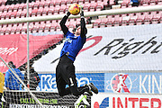 Bury Goalkeeper, Ian Lawlor warms up before the Sky Bet League 1 match between Wigan Athletic and Bury at the DW Stadium, Wigan, England on 27 February 2016. Photo by Mark Pollitt.
