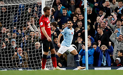 Manchester City's Ilkay Gundogan celebrates scoring his side's third goal of the game during the Premier League match at the Etihad Stadium, Manchester.