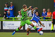 Oldham Athletic defender Zak Mills tussles with Forest Green Rovers forward George Williams (11) during the EFL Sky Bet League 2 match between Forest Green Rovers and Oldham Athletic at the New Lawn, Forest Green, United Kingdom on 3 August 2019.