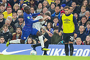 Chelsea midfielder Ngolo Kante (7) tackles Derby County defender Scott Malone (46) during the EFL Cup 4th round match between Chelsea and Derby County at Stamford Bridge, London, England on 31 October 2018.