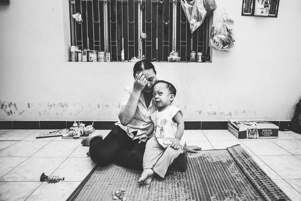Luu Thi Thu, 44, and her son, Van Dung Tuan Tu, 4, at their house near the airport in Danang, Vietnam, on August 8, 2012. Young Tu's physical and mental disabilities are thought to be caused by his father's exposure to Agent Orange dioxins at the Danang airport where he works dredging near contaminated sites.