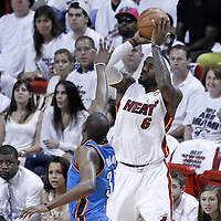 17 June 2012: Miami Heat small forward LeBron James (6) takes a jumpshot over Oklahoma City Thunder small forward Kevin Durant (35) during the Miami Heat 91-85 victory over the Oklahoma City Thunder, in Game 3 of the 2012 NBA Finals, at the AmericanAirlinesArena, Miami, Florida, USA.
