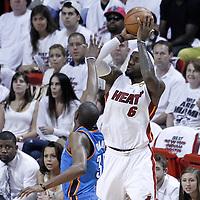 17 June 2012: Miami Heat small forward LeBron James (6) takes a jumpshot over Oklahoma City Thunder small forward Kevin Durant (35) during the Miami Heat 91-85 victory over the Oklahoma City Thunder, in Game 3 of the 2012 NBA Finals, at the AmericanAirlinesArena, Miami, Florida, USA.