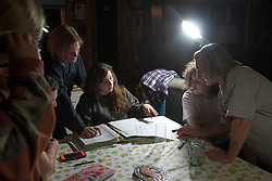 Joan Wortman looks over pedigree and registration records for her herd of Milking Shorthorns with her VTC student employees and Rita Villar Parajo, second from right, an exchange student living with the Wortmans, after their weekly dinner and meeting in Bethel, Vt., Monday, April 18, 2016.  (Valley News - James M. Patterson) Copyright Valley News. May not be reprinted or used online without permission. Send requests to permission@vnews.com.