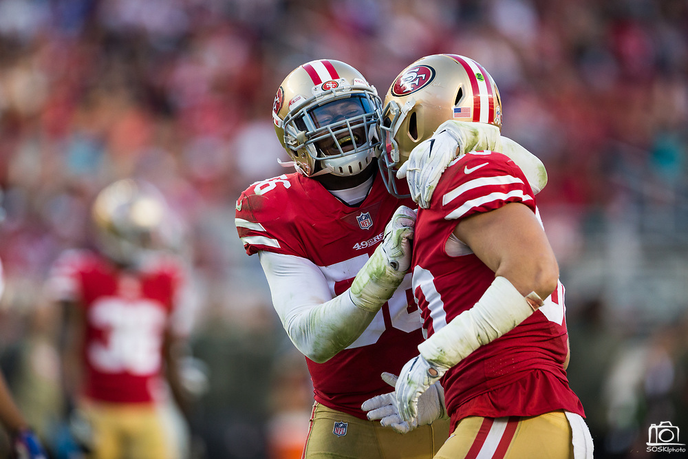 San Francisco 49ers outside linebacker Reuben Foster (56) (left) celebrates with San Francisco 49ers middle linebacker Brock Coyle (50) after making a defensive stop against the New York Giants at Levi's Stadium in Santa Clara, Calif., on November 12, 2017. (Stan Olszewski/Special to S.F. Examiner)