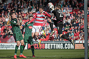 Luke McCormick (Captain) (Plymouth Argyle) gathers the ball from Mathieu Baudry (Doncaster Rovers) during the EFL Sky Bet League 2 match between Doncaster Rovers and Plymouth Argyle at the Keepmoat Stadium, Doncaster, England on 26 March 2017. Photo by Mark P Doherty.