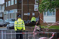 © Licensed to London News Pictures. 02/05/2018. LONDON, UK.  A police cordon surrounds the scene of a shooting in Queensbury, north west London.  A man was fatally shot and another injured following the shooting in Cumberland Road adjacent to Queenbury tube station.  Photo credit: Stephen Chung/LNP