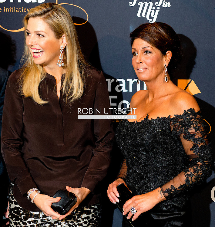 05-11-2013 Amsterdam Queen Maxima with Rachel Hazes at the benefit performance of the musical &ldquo; Hij Gelooft in Mij&rsquo;&rsquo; at the DeLaMar theater in Amsterdam.<br /> The proceeds of the benefit performance of the musical about the life of Dutch singer Andre Hazes is donated to the Children making music program of the Oranje Fonds. COPYRIGHT ROBIN UTRECHT