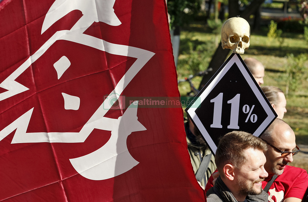 October 6, 2018 - Kiev, Ukraine - Ukrainian activists carry flags during ''March for the right to self-defense'' in Kiev, Ukraine, 06 October,2018. They stand for rights to protect ourselves and loved ones with weapons and not to be punished for it,activists said. (Credit Image: © Str/NurPhoto/ZUMA Press)