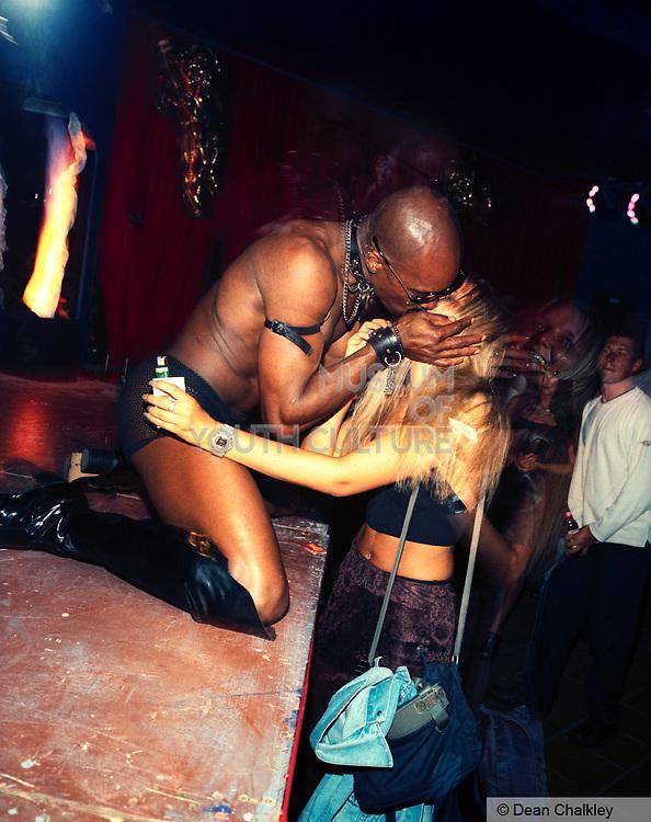 Male stripper kissing a woman, Ibiza. 1999