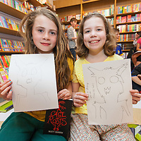 Molly O'Connell and SInead Ní Dhúlaing with their goblin drawing at the Book Launch at Ennis Book Shop, A Cage of Roots by Matt Griffin