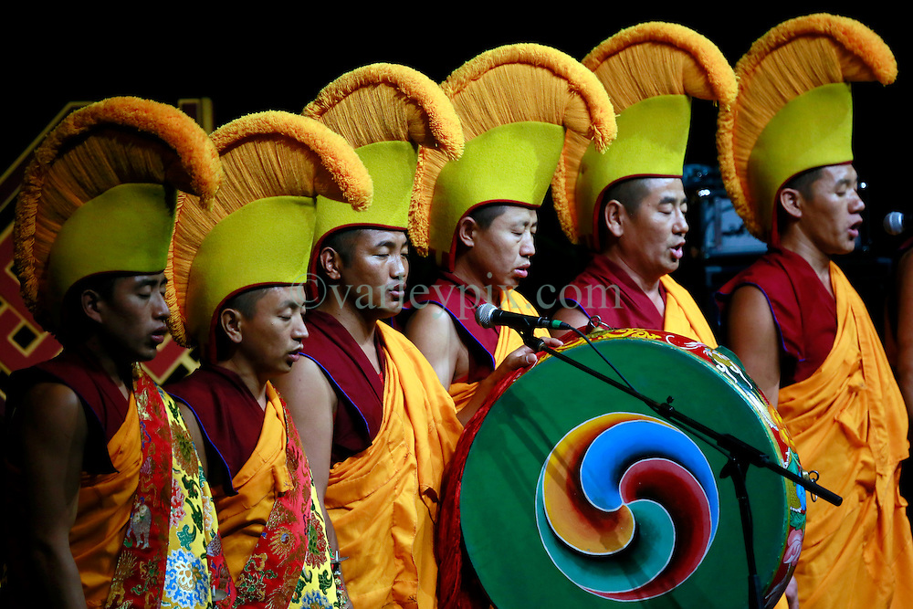 18 May 2013. New Orleans, Louisiana,  USA..Buddhist monks chant before the arrival of His Holiness the 14th Dalai Lama at the University of New Orleans Lakefront Arena for the 'Resiliance - Strength through Compassion and Connection' conference. .Photo; Charlie Varley.