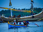 29 JULY 2017 - AIRKUNING, BALI, INDONESIA: A small outrigger fishing canoe returns to port in Kuning, a Muslim fishing village on the southwest corner of Bali. Villagers said their regular catch of fish has been diminishing for several years, and that are some mornings that they come back to shore with having caught any fish.    PHOTO BY JACK KURTZ
