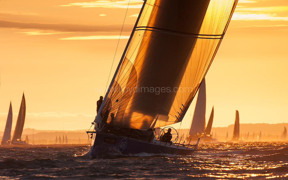 J.P.Morgan Asset Management Round the Island Race 2013. Pictures of the Tonnerre De Breskens 3 (NED46) crossing the start line as the sun rises this morning.