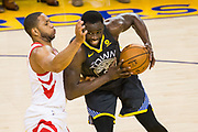 Golden State Warriors forward Draymond Green (23) handles the ball against the Houston Rockets during Game 4 of the Western Conference Finals at Oracle Arena in Oakland, Calif., on May 22, 2018. (Stan Olszewski/Special to S.F. Examiner)
