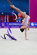 Vladinova Neviana during the qualifying ribbon at the Pesaro World Cup 2018. Neviana come from Bulgaria. She is born in Pleven in 1994. Her dream is to win a medal at the 2020 Olympic Games in Tokyo.