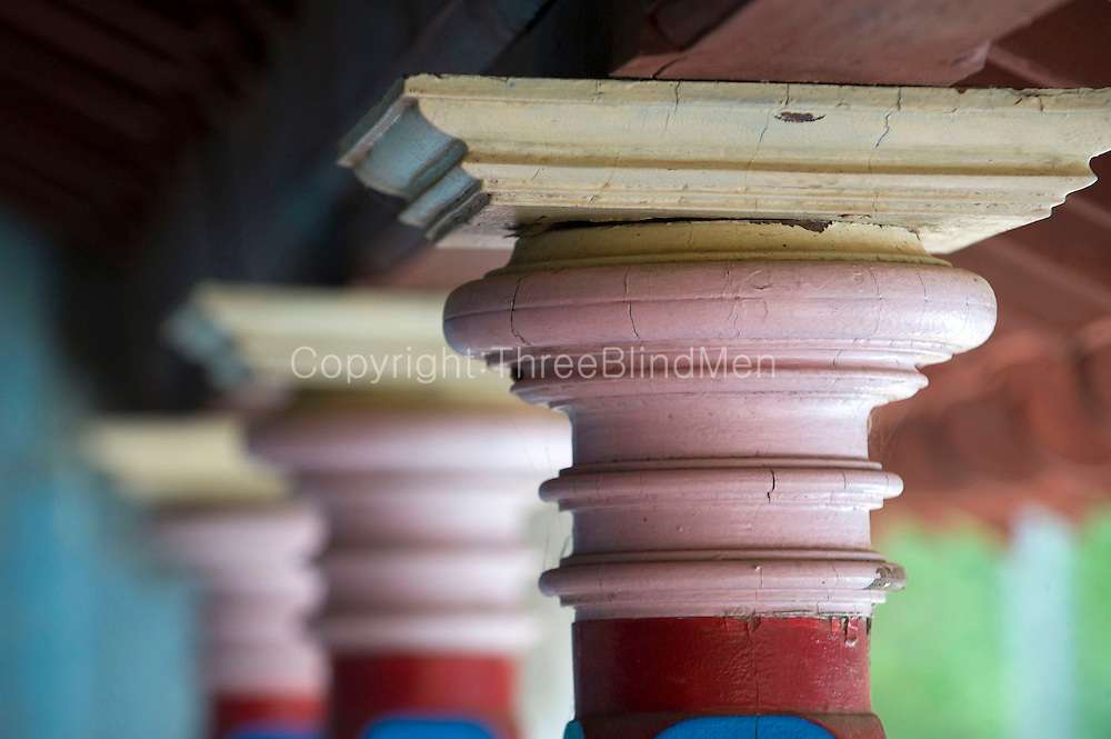 Detail of painted capital. Street in Thittacheri. <br /> Tamil Nadu. South India.