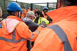 Harefield, UK. 8 February, 2020. HS2 engineers try to block environmental activists who had crawled through a ditch under a road closure implemented by HS2 engineers on Harvil Road in the Colne Valley to facilitate tree felling works for the high-speed rail project. Environmental activists based at a series of wildlife protection camps in the area prevented the tree felling works for the duration of the weekend for which they were scheduled.